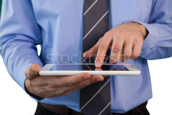 Mid section of businessman using tablet Stock photo © wavebreak_media