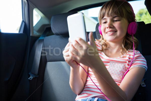 наушники цифровой таблетка назад сиденье Сток-фото © wavebreak_media