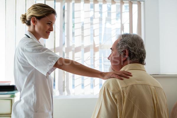 Doctor talking to senior man in nursing home Stock photo © wavebreak_media