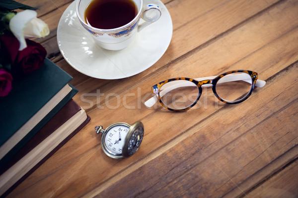 Stockfoto: Bril · stopwatch · thee · boeken · tabel