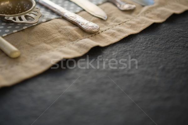 Cropped image of cutlery on napkin Stock photo © wavebreak_media