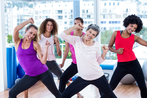 Portrait of cheerful women exercising with clasped hands Stock photo © wavebreak_media