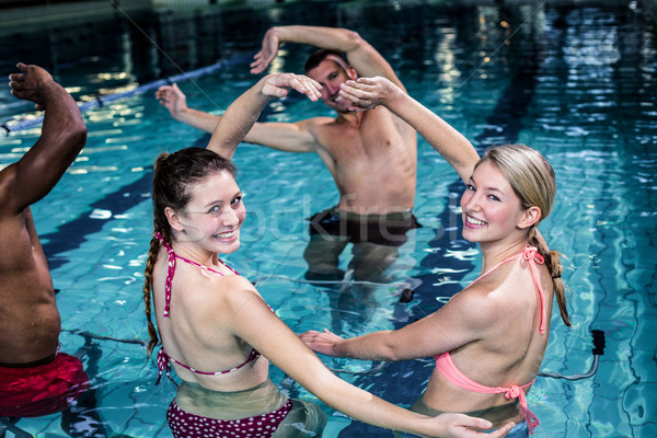 Fit people doing an aqua aerobics class Stock photo © wavebreak_media
