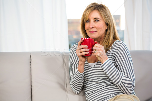 Vrouw beker sofa koffie schoonheid Stockfoto © wavebreak_media