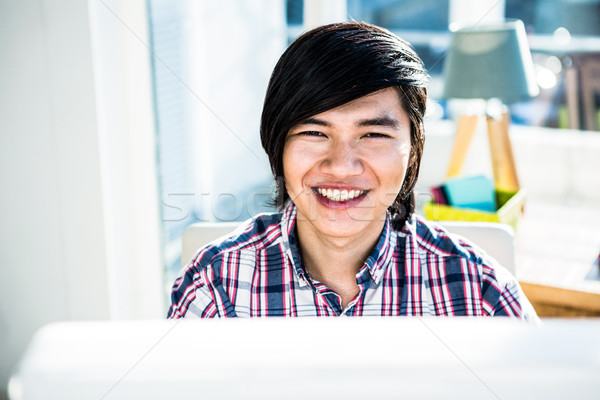 Smiling hipster businessman looking at camera  Stock photo © wavebreak_media