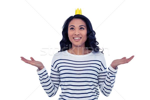 улыбаясь азиатских женщину бумаги корона белый Сток-фото © wavebreak_media