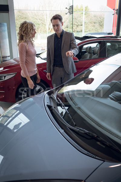 Female customer looking at salesman showing car Stock photo © wavebreak_media
