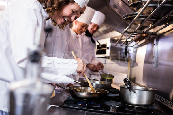 Group of chef preparing food in the kitchen Stock photo © wavebreak_media