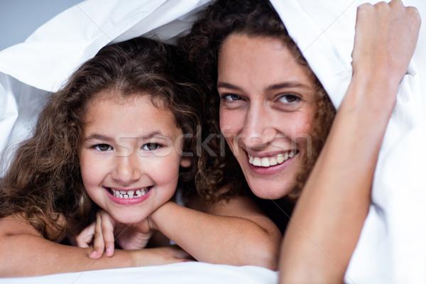 Portre anne kız beyaz battaniye yatak odası Stok fotoğraf © wavebreak_media