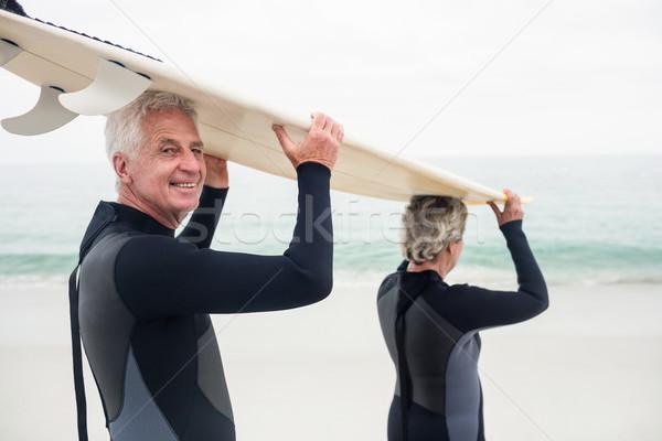 Tavola da surf testa spiaggia donna Foto d'archivio © wavebreak_media