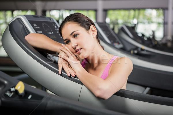 Woman leaning on treadmill Stock photo © wavebreak_media