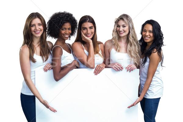 Több nemzetiségű nők tart fehér tábla fehér nő Stock fotó © wavebreak_media