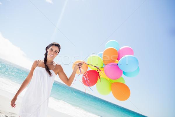 Güzel bir kadın balon plaj mutlu deniz Stok fotoğraf © wavebreak_media
