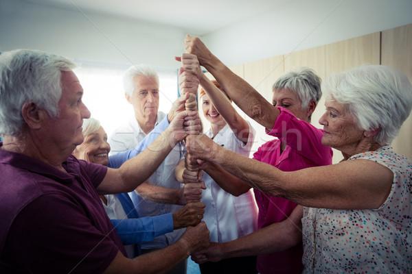 Stock photo: Group of seniors playing