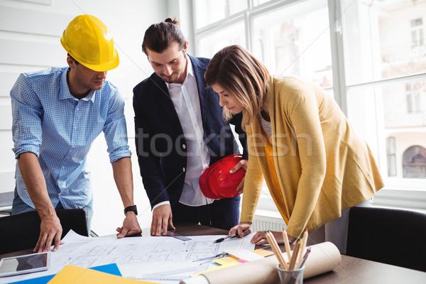 Business people with blueprint on table Stock photo © wavebreak_media