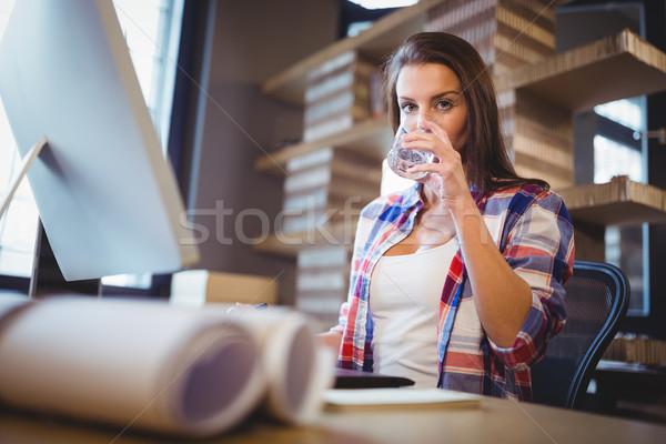 деловая женщина питьевая вода Creative служба портрет компьютер Сток-фото © wavebreak_media