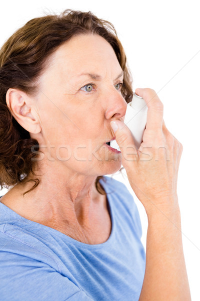 Mature woman using asthma inhaler Stock photo © wavebreak_media