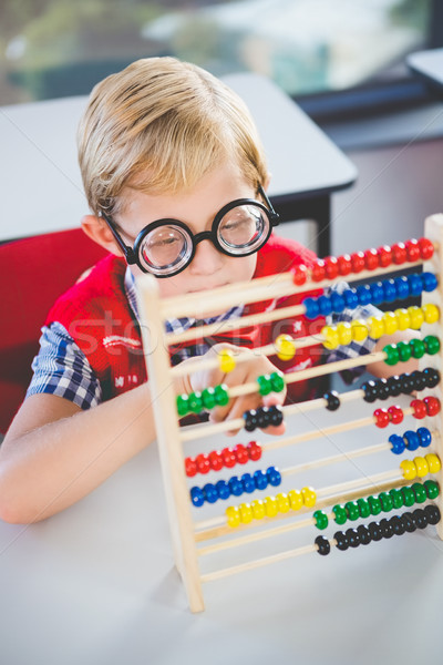 Close-up of schoolkid counting abacus in classroom Stock photo © wavebreak_media