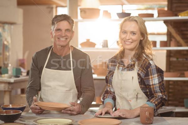 Sonriendo cerámica taller retrato mujer Foto stock © wavebreak_media