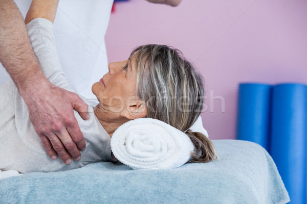 Physiotherapist massaging a senior womans shoulder  Stock photo © wavebreak_media