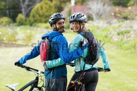 Motoros pár hegyi kerékpár vidék boldog nő Stock fotó © wavebreak_media