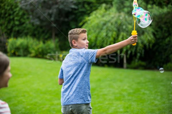 Ninos jugando burbujas parque nina bebé Foto stock © wavebreak_media