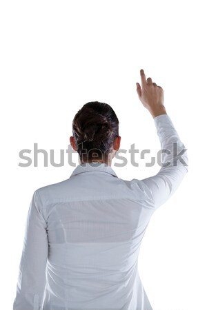 Businessman pretending to touch an invisible screen Stock photo © wavebreak_media