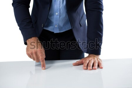 Businessman pretending to touch an invisible object Stock photo © wavebreak_media