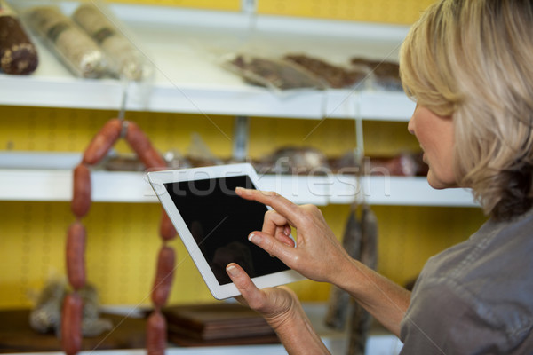 Female staff using digital tablet at counter Stock photo © wavebreak_media