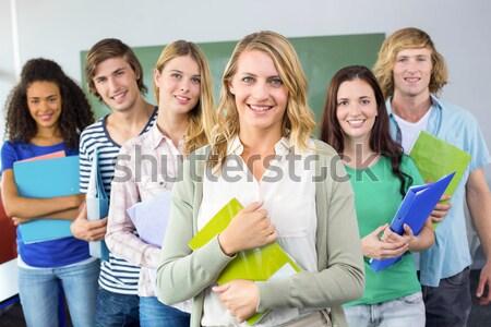 Collège élèves dossiers blanche carrelage Photo stock © wavebreak_media