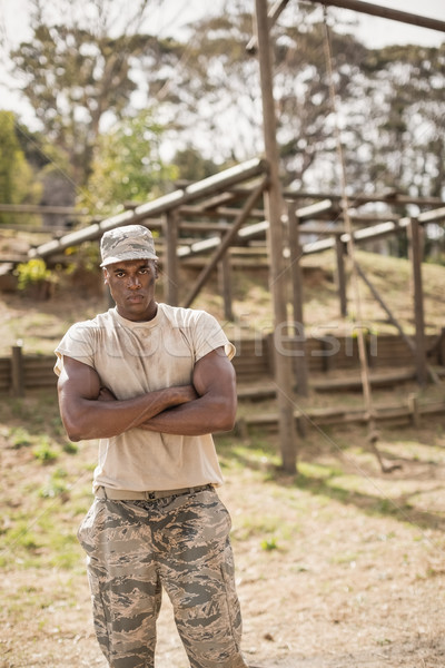 Military man standing with arms crossed during obstacle course in boot camp Stock photo © wavebreak_media