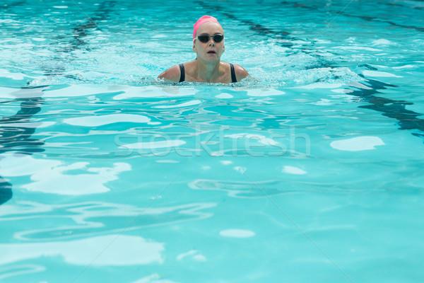 Woman wearing goggles while swimming in pool Stock photo © wavebreak_media