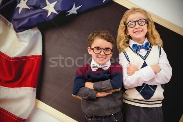 Composite image of cute pupils looking at camera Stock photo © wavebreak_media