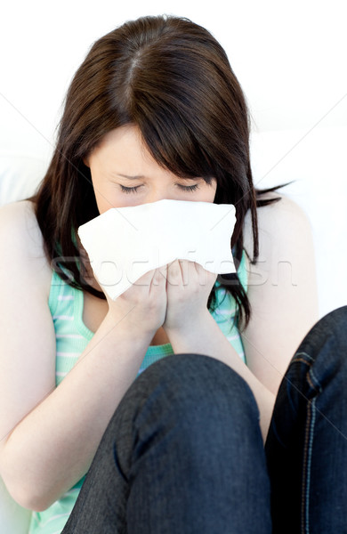 Portrait of a sick brunette woman blowing  Stock photo © wavebreak_media