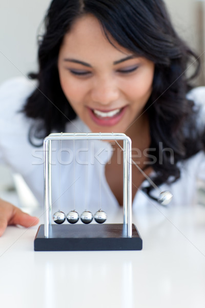 Businesswoman having fun with Newton balls Stock photo © wavebreak_media