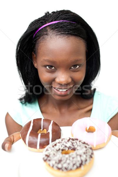 Charming young woman looking at donuts  Stock photo © wavebreak_media