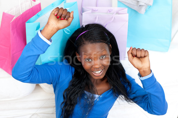 Cheerful woman punching the air in celebration after shopping Stock photo © wavebreak_media