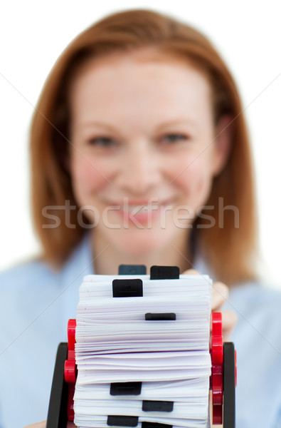 Young businesswoman consulting her business card holder Stock photo © wavebreak_media