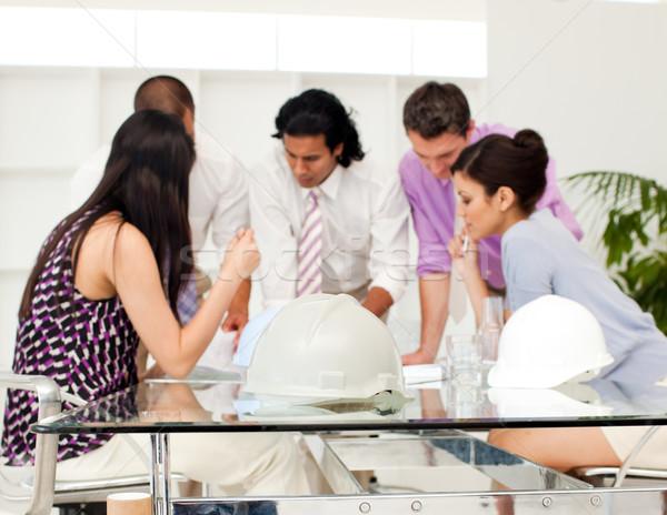 Internationale architect blauwdrukken vergadering business Stockfoto © wavebreak_media