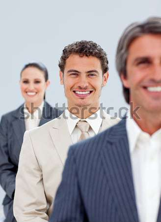 Stock photo: Smiling multi-ethnic business people standing together