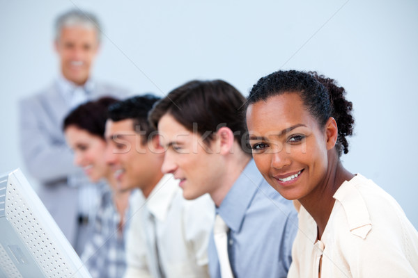 Confident business people with their senior manager Stock photo © wavebreak_media