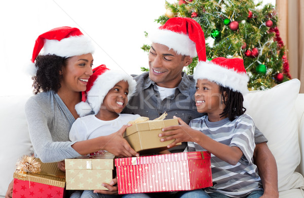 Afro-American family celebrating Christmas at home Stock photo © wavebreak_media