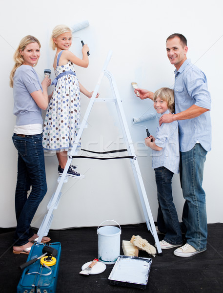 Happy Family decorating their new home Stock photo © wavebreak_media
