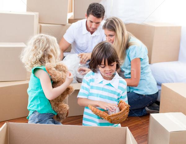 Caucasian family packing boxes Stock photo © wavebreak_media