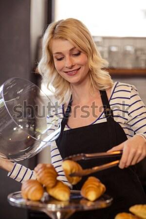 Charming young woman using a dishwasher  Stock photo © wavebreak_media