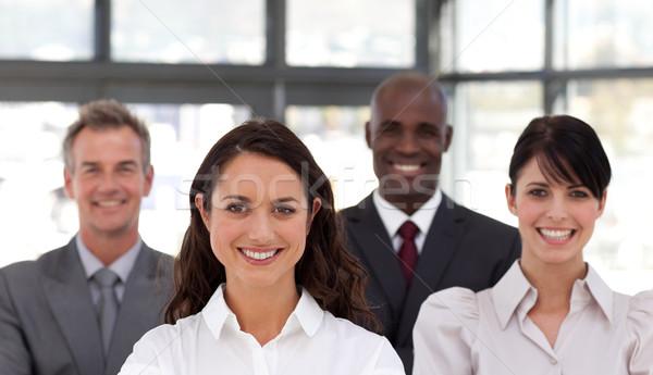 бизнес-команды Постоянный вместе улыбаясь камеры улыбка Сток-фото © wavebreak_media