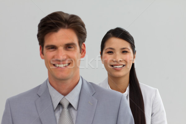Internationale bedrijfsleven mensen permanente lijn glimlachend camera Stockfoto © wavebreak_media