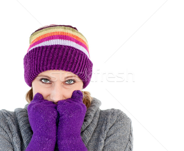 Young woman holding her hands before her face wearing a colourful hat and a grey pullover Stock photo © wavebreak_media