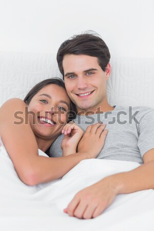 Husband and wife lying in bed using a laptop  Stock photo © wavebreak_media