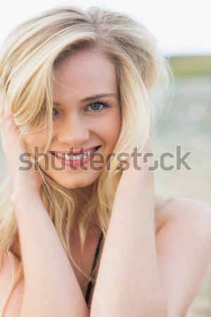 Cute mujer mentiras marrón sofá casa Foto stock © wavebreak_media